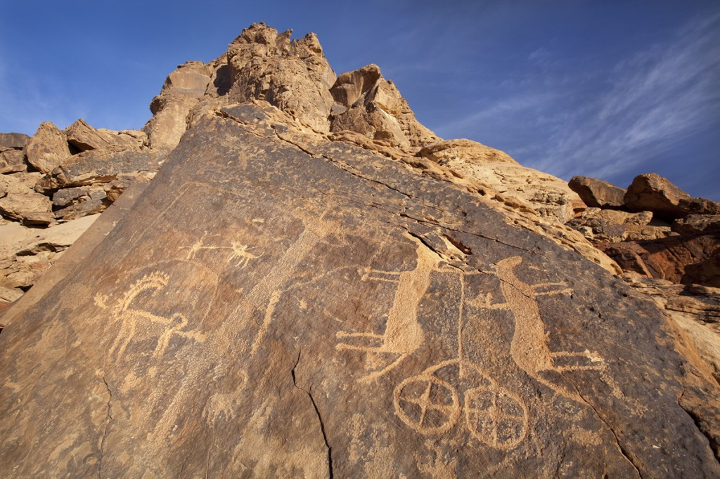 The petroglyph of a chariot pulled by two horses at Jubbah that Euting illustrated. Note that Euting did not indicate the damage to the head of the horse on the left or the rider added to the horse on the right by a later artist.