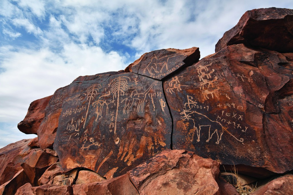 This petroglyph panel at Jabal Yatib was shallowly scratched through the dark desert varnish.  The subjects (lion, palm trees, camels, horses, and writing), as well as the technique, indicate that it was done after the Holocene Wet Phase.