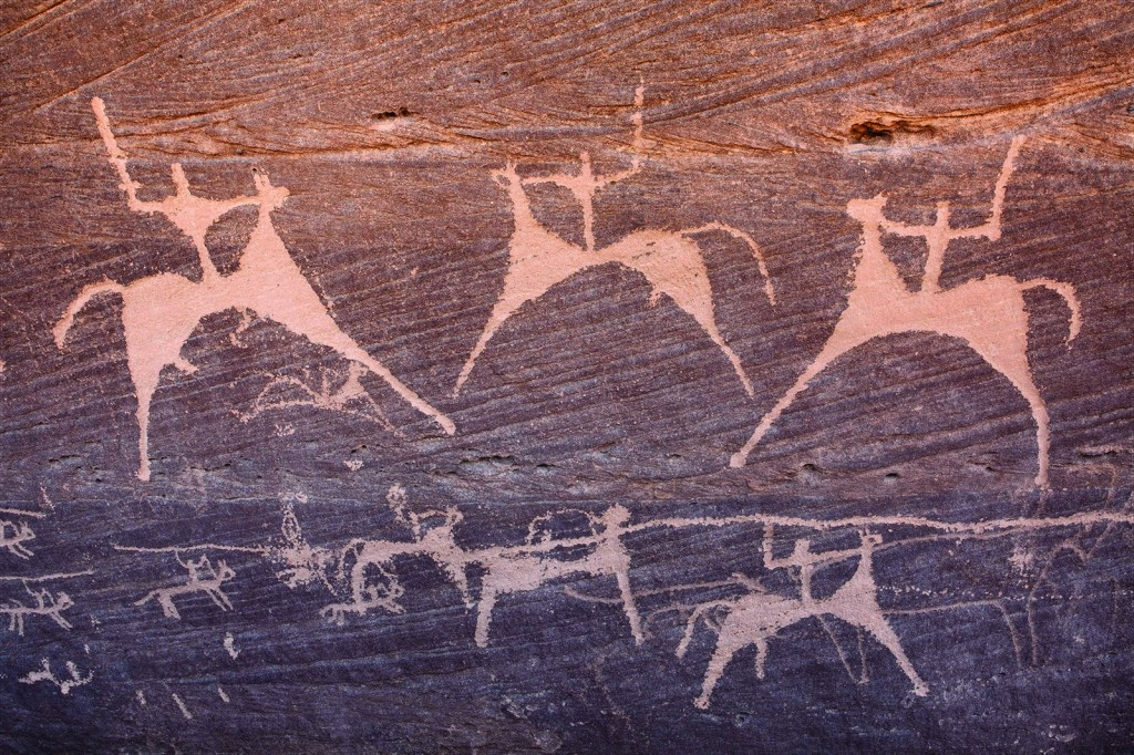 Close-up of Painted Bull petroglyph, at Bi'r Hima, showing cavalrymen with swords and lances.